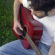 Man playing acoustic guitar — Stock Photo #3147104