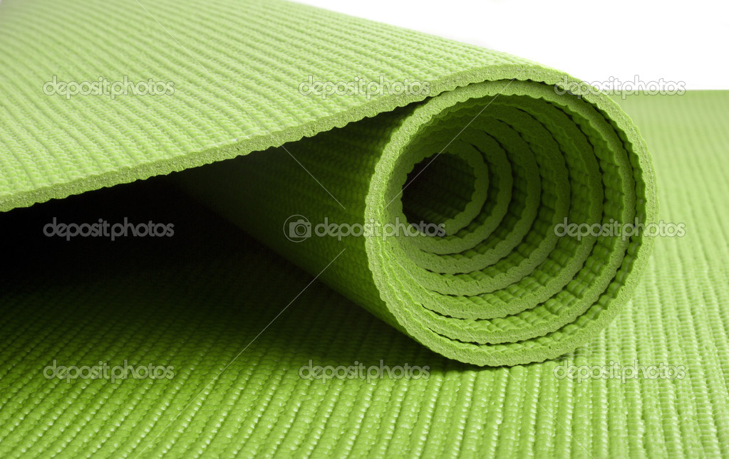 A green yoga/pilates/exercise mat rolled up on white — Stock Photo #3410691