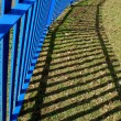 Foto Stock: Blue fence