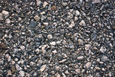 Road surface of crushed stone marble — Stock Photo