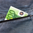 Euro banknotes in the back pocket — Stock Photo