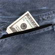 Jeans rear pocket with $100 bills - Stock Photo