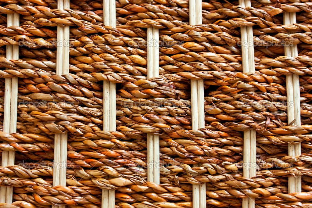 Texture of rustic interlaced straw of a handmade — Stock Photo #2745915