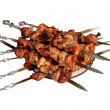 Shish kebab skewer, folded on a platter. Шашлык на шампурах. — Stock Photo