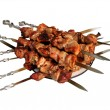 Shish kebab skewer, folded on a platter. Шашлык на шампурах. - Stock Photo