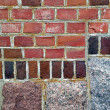 Red bricks and stones wall — Stock Photo