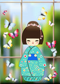 Japanese doll with butterflies — Stock Photo