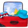 Travel red suitcase packed for vacation - Stock Photo