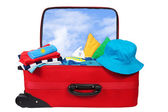 Travel red suitcase packed for vacation — Stock Photo