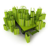 Green shopping bags on a pallet truck — Stock Photo