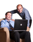 Happy young businessmen — Stock Photo