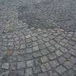 Dirty cobblestone road — Stock Photo