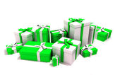 Gift boxes in white and green — Stock Photo