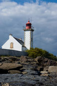 Lighthouse from the rocks — Stock Photo