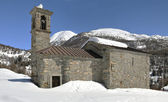 Romanesque church in mountain landscape — Stock Photo