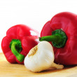 Two red peppers and a clove of garlic — Stock Photo
