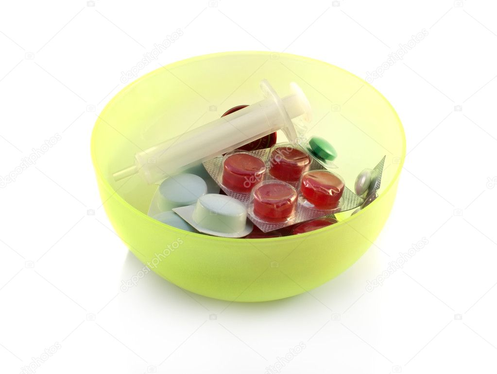 Pills in a bowl isolated on white background — Stock Photo #2802906