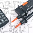 Stock Photo: Voltage tester,calculator