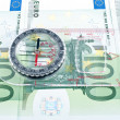 Currency and compass — Stockfoto