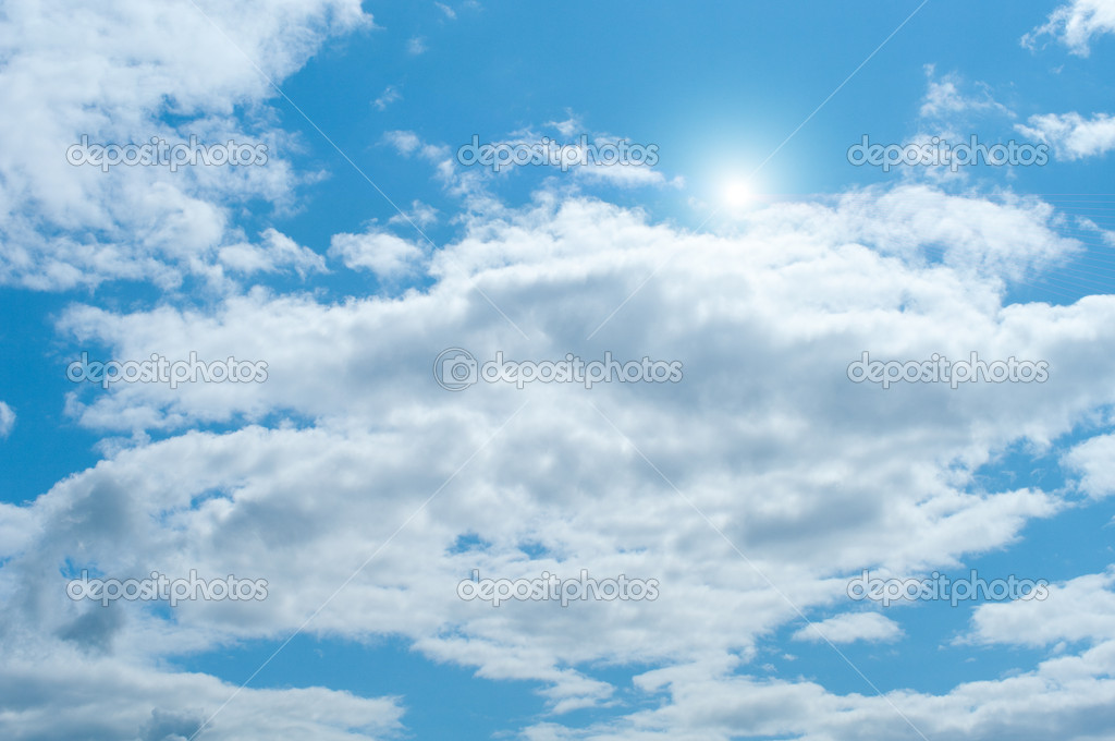 Beautyful cloudy blue sky with sun — Stock Photo #3340554