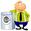 Man leaning on the washing machine. - Stock Photo