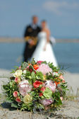 Wedding bouquet, bride and groom. — Stock Photo