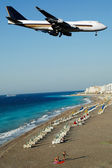 Plane over beach — Stock Photo