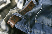 Jeans, leather belt and a shirt — Stock Photo