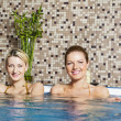 Two Young Women in Hot Tub - Stock Photo