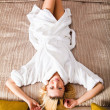 Woman Lying on Bed dressed in robe — Stock Photo