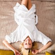 Woman Lying on Bed dressed in robe — Stock Photo #2860687