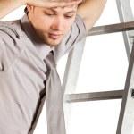 Businessman climbink n ladder — Stock Photo