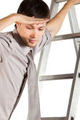 Businessman climbink n ladder — Stock Photo