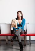 Worried woman sitting and looking up — Stock Photo