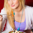 Young Woman Eating Dinner — Stock Photo
