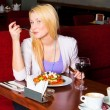 Young Woman Eating Dinner — Stock Photo #2971548