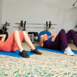 Stock Photo: Two Young Women in Gym