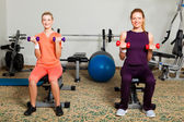 Two Young Women in Gym — Stock Photo