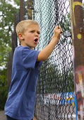 An angry young boy shouting — Stock Photo