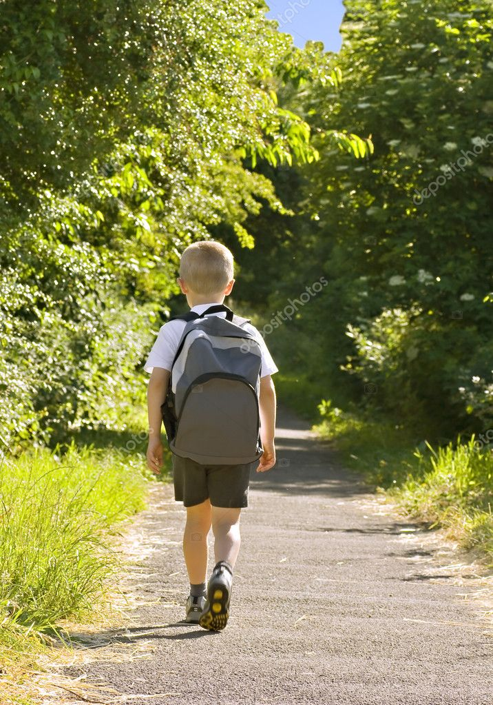 Young boy wearing a backpack ready for school  Stock Photo #3044256