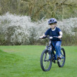 A young six year old boy riding his bke — Foto de Stock