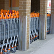 A row of shopping trolleys — Stock Photo