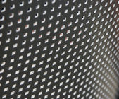 Plastic grille with small square holes — Stock Photo