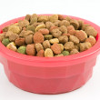Dried dog food in a pink bowl — Stock Photo