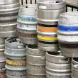 Stock Photo: Metal beer kegs stacked up outside of bar