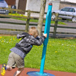 Young six year old boy plays in the park — Lizenzfreies Foto