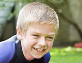 Eight year old boy smiling at the camera — Stock Photo