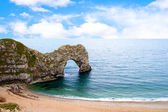 Durdle Door a naturally eroded limestone arch in Dorset UK — Stock Photo