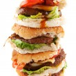 Stacked fat hamburgers — Stock Photo