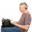 Elderly man is writing a letter — Stock Photo #2717114